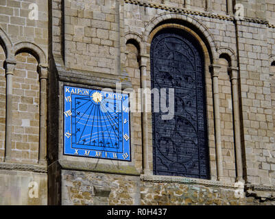 Sundial on the south side of Ely Cathedral in Cambridgeshire. The inscription is Greek reading 'Kairon Gnothi' meaning 'Choose the timely moment'. - Stock Image