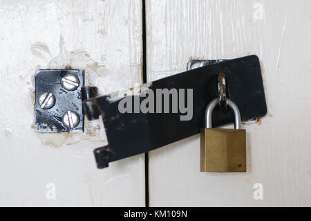 Broken latch with padlock still in place - Stock Image