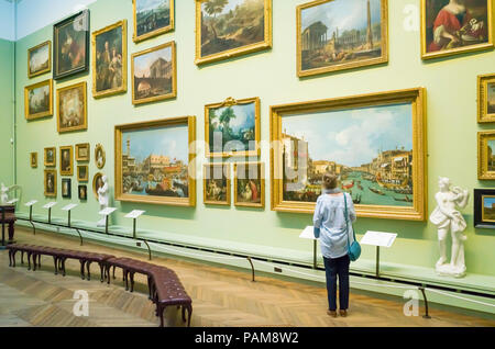 A senior woman viewing a Canaletto painting in the Art Gallery at the Bowes Museum Barnard Castle Co.Durham England - Stock Image