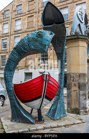 Fish and Boat, a sculpture by Jois Hunter and Peter Johnson, Commercial Quay, Leith, Edinburgh, Scotland, UK - Stock Image