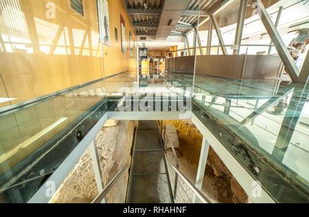 Cartagena, Spain - September 14th, 2018: Glass floor of Punic Wall Interpretation Center - Stock Image
