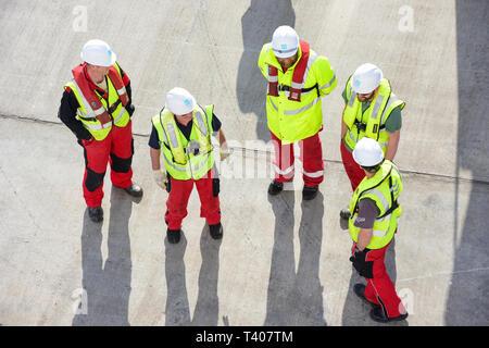 Workmen with hard hats on cruise ship wharf, Lerwick, Shetland, Northern Isles, Scotland, United Kingdom - Stock Image