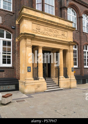 Ornate stone porch and entrance to Norwich Technical Institute Building (now St George's Building, Norwich University of the Arts), Norwich, England. - Stock Image