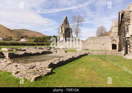 The ruins of Valle Crucis Abbey viewed from the dining hall. Founded as a Cistercian monastery in 1201 and closed in 1537 - Stock Image
