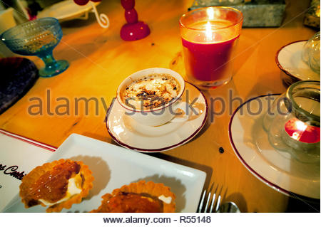 Tasty treat on a cold winters day! Christmas food with hot chocolate Magic candles - Stock Image