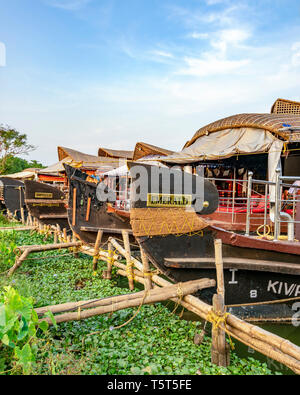 Vertical view of a traditional riceboats moored in Kerala, India. - Stock Image