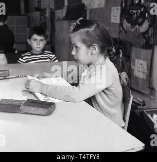 1960s, historical, young girl in a classroom, England, UK. - Stock Image
