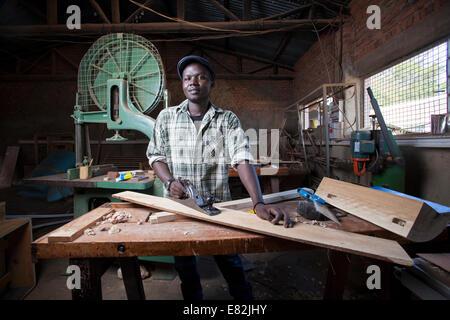 Rwandan carpenter in his workshop, Kigali, Rwanda. - Stock Image