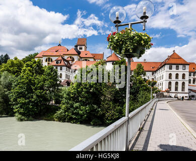 Benedictine monastery at river Lech, part of castle on top of hill, historic downtown Füssen,   Bavaria, Germany - Stock Image