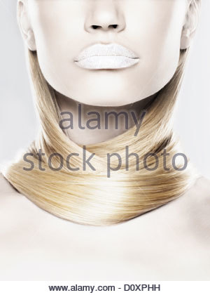 Young woman with hair wrapped around neck - Stock Image