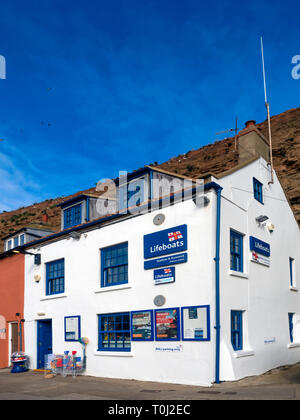 Cottage converted into an RNLI charity shop below the cliff at Cow Bar Nab  Staithes North Yorkshire - Stock Image