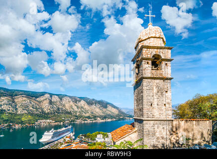 The tower of Saint John Church, under the ruins of the Castle Fortress of San Giovanni, overlooking the Bay of Kotor in Kotor, Montenegro - Stock Image