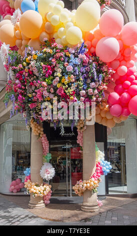 Fenwick of Bond Street London flower and balloon decorations outside the entrance - Stock Image