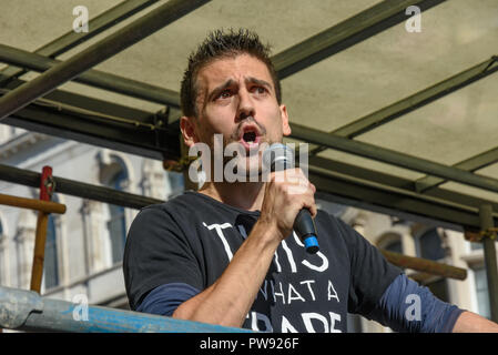 London, UK. 13th October 2018. JUnior doctor  and Momentum member Yannis Gourtsoyannis speaks at a rally in London close to where the racist, Islamophobic DFLA were ending their march on Whitehall bringing together various groups to stand in solidarity with the communities the DFLA attacks. The event was organised by Stand Up To Racism and Unite Against Fascism. Peter Marshall/Alamy Live News - Stock Image