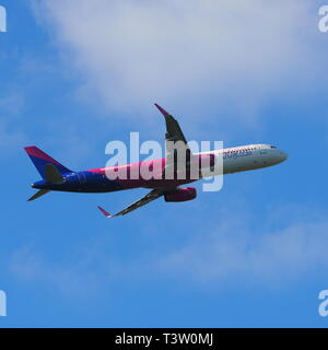 Wizz Air passenger jet aircraft taking off from Luton Airport, Bedfordshire, England, UK - Stock Image
