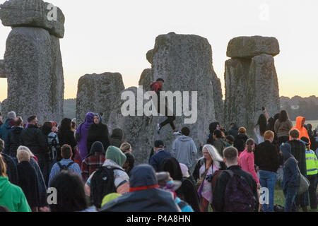 Stonehenge, Amesbury, UK, 21st June 2018,   Rulebreaker jumping down from the stone before the marshals and police reach the stone  Credit: Estelle Bowden/Alamy Live News. - Stock Image