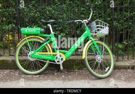 A Lime-E bicycle - a GPS enabled Electric bike hire scheme in London - Stock Image