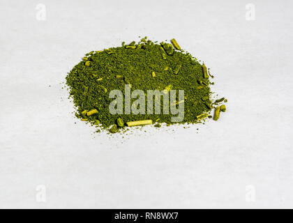 Green mate herb on white background used to make the Brazilian traditional  drink (chimarrao) on white background, top view - Stock Image