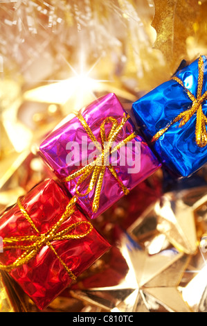 colorful gift boxes with decoration in gold - Stock Image