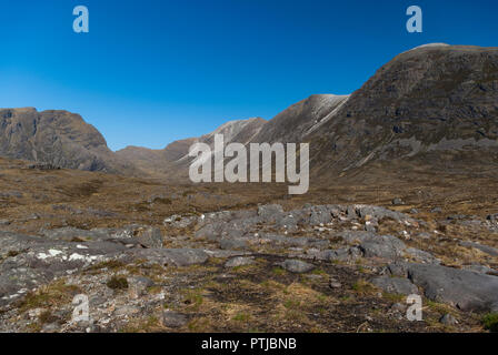The Scottish Munro of Beinn Liath Mhor seen from Sgorr Ruadh, note the distinctive bands of quartzite and sandstone, Achnashellach, Wester Ross, UK - Stock Image