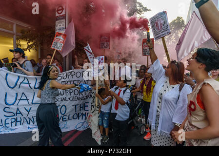 London, UK. 3rd July 2018. Protesters outside Southwark Council Offices hold banners, placards and a red smoke flare calling on the Council Planning Committee to reject the plans by tax avoiding property giant Delancey and University of the Arts London to demolish the Elephant & Castle Shopping Centre  and replace it with luxury housing and a new building for the London College of Communication. Credit: Peter Marshall/Alamy Live News - Stock Image