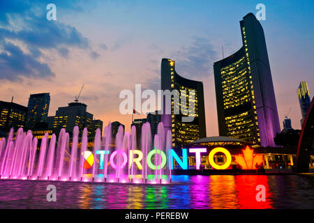 Toronto, Ontario/Canada - August 16, 2018: City Hall with Selfie Sign time lapse with colorful reflections in the reflecting pool - Stock Image