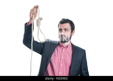 Portrait of a businessman looking at a gallows in his hand - Stock Image