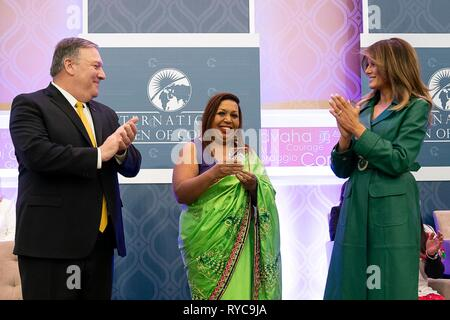 U.S First Lady Melania Trump, right, and Secretary of State Mike Pompeo, left, present Marini de Livera of Sri Lanka with the 2019 International Women of Courage awards at the State Department March 7, 2019 in Washington, DC. - Stock Image