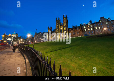 Night view of Edinburgh University New College building on The Mound in Edinburgh Old Town, Scotland, UK - Stock Image
