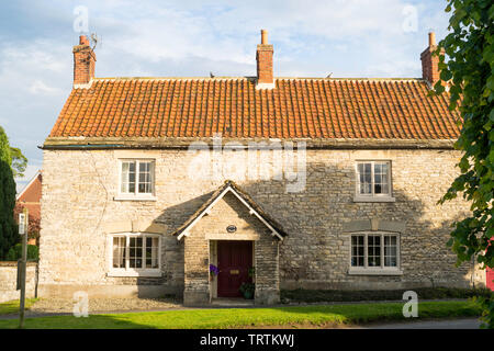 The Porch House, a farmhouse on The Green, in Slingsby, North Yorkshire, England, UK - Stock Image