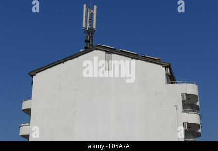 Facade of an apartment block with mounted calf Communication antennas. - Stock Image