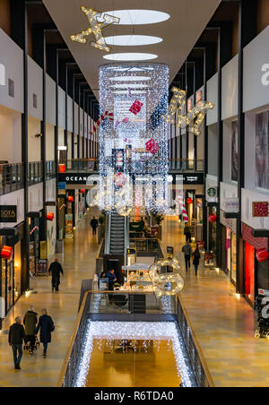 Ocean Terminal, Leith, Edinburgh, Scotland, United Kingdom, 6th December 2018. The shopping centre is lit up with Christmas decorations, but few shoppers are evident on a weekday in early December - Stock Image