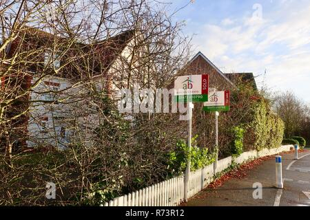 Austwick Berry estate agents For Sale and Sold boards on a modern housing estate in Kesgrave near Ipswich, Suffolk. December 2018. - Stock Image