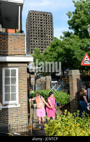 London, UK. 15th Jun, 2017. Residents cleaning up one day after the Grenfell Tower fire. The Grenfell Tower fire - Stock Image