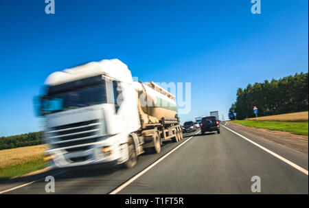 Delivery truck on highway with speed effect - Stock Image