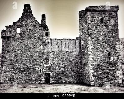Lochranza Castle in vintage black and white style. - Stock Image