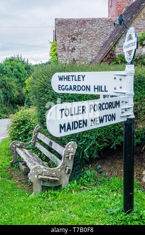 Village Direction signpost at Powerstock Village in Dorset England. - Stock Image