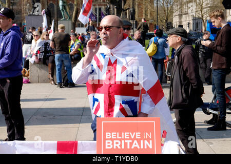 London, UK. 29th Mar, 2019. Hundreds of pro-Brexit supporters protest in parliament square, as UK was meant to leave European union today. Credit: Yanice Idir/Alamy Live News - Stock Image