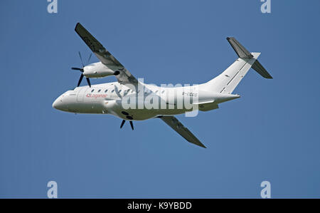 A Dornier 328-100 from the Loganair fleet, Scotland's Airline departing from Inverness on an internal flight. - Stock Image