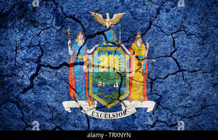 Flag of the New York on dry earth ground texture background - Stock Image