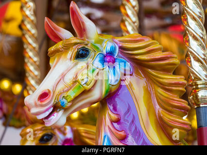Close up of a horse head on a merry go round amusement attraction at Albert Dock Liverpool August 2018 - Stock Image