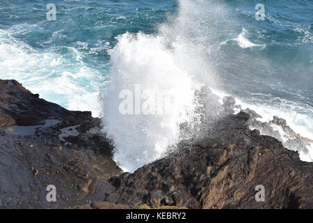 Halona Blowhole in the Southeast corner of Oahu, Hawaii is a natural opening in the rocks that spews water like - Stock Image