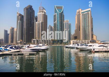 Dubai, United Arab Emirates - September 8, 2018: Yachts and skyscrapers at Dubai Marina on September 8, 2018, Dubai, United Arab Emirates. - Stock Image