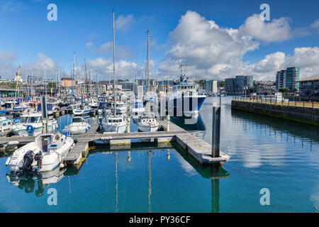 2 June 2018: Plymouth, Devon, UK - Sutton Pool, or Sutton Harbour, on a warm and bright spring day. - Stock Image
