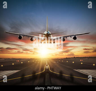 Huge two storeys commercial jetliner taking of runway. Modern and fastest mode of transportation. Dramatic sunset sky on background - Stock Image