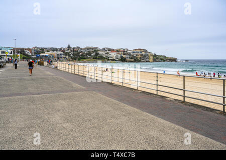 View to the north end of Bondi Beach, Sydney, Australia.  It is in the suburb of Bondi and is popular with locals and tourists. - Stock Image