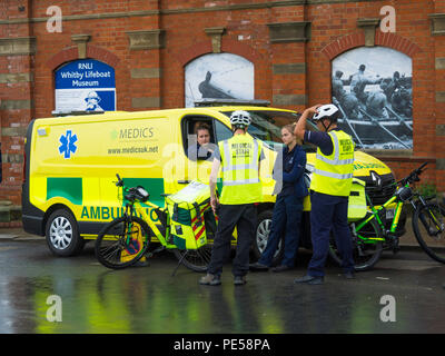 Medics Emergency Response Ambulance service on bicycles in crowded town centre not easily accessible for vehicles during the Whitby Regatta - Stock Image