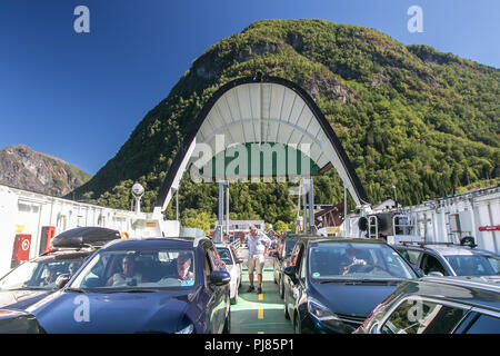 Norway, July 26, 2018: Cars are parked on deck of a ferry that has its door open. - Stock Image