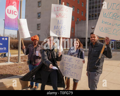 Chicago, Illinois, USA. 19th March 2019.  Graduate Assistants picket in from of the University of Illinois at Chicago's School of Public Health. The graduate workers are asking for a living wage and not having fees equal to 10% of their income deducted from their pay. Credit: Todd Bannor/Alamy Live News - Stock Image