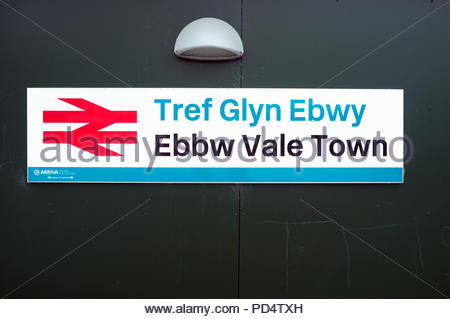 Ebbw Vale Town / Tref Glyn Ebwy - place name sign at the town's railway station. Ebbw Vale, Blaenau Gwent, south Wales, UK. - Stock Image